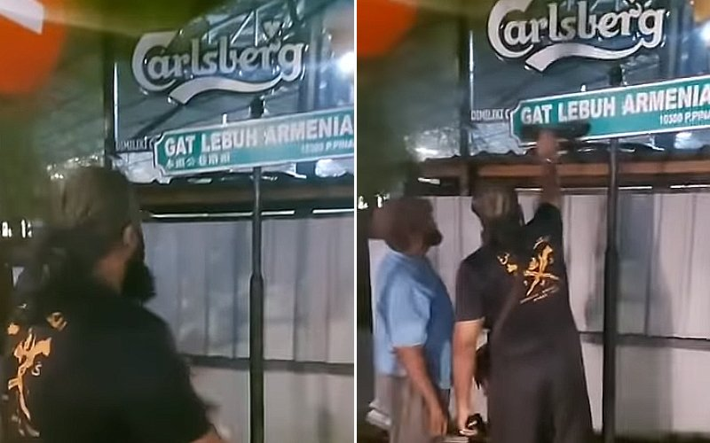 removing-Chinese-writing-on-a-street-sign-in-Penang.jpg